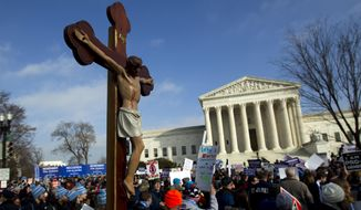 In this Friday, Jan. 18, 2019, file photo, anti-abortion activists march outside the U.S. Supreme Court building, during the March for Life in Washington. (AP Photo/Jose Luis Magana) ** FILE **