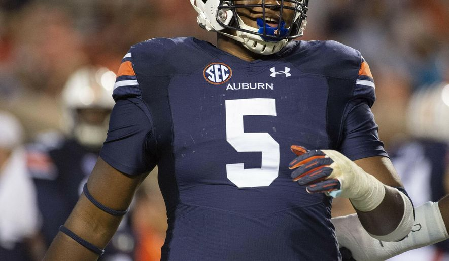 FILE - In this Sept. 29, 2018, file photo, Auburn defensive lineman Derrick Brown (5) warms up after a lightning delay in the first half of an NCAA college football game between Southern Miss and Auburn, in Auburn, Ala. (AP Photo/Vasha Hunt, File)