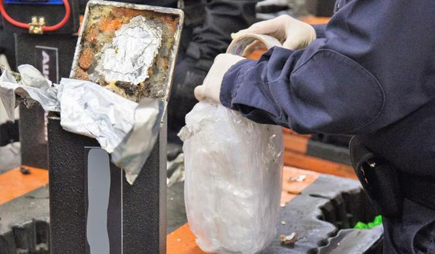 This photo provided by U.S. Customs and Border Protection shows an officer extracting methamphetamine from a loudspeaker on Jan. 11, 2019 at the Los Angeles-Long Beach seaport.  Australian police arrested six people after what authorities said Friday, Feb. 8, 2019  was the largest single seizure of methamphetamine in the United States and the biggest drug haul bound for Australia. U.S. Customs and Border Protection said 1,728 kilograms (3,800 pounds) of the drug were seized mid-January at the Los Angeles-Long Beach port complex along with smaller amounts of cocaine and heroin.  (U.S. Customs and Border Protection via AP)