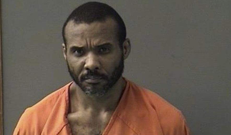 "FILE - This undated booking photo released by Bell County Sheriff's Office shows Cedric Marks. The MMA fighter accused of killing two people before escaping from a private prison van says he had ""nothing to do with"" the bodies found buried in Oklahoma last month. Marks told KPRC2 during a Thursday, Feb. 7, 2019, video call from a Texas jail that he's not guilty of the slayings of Jenna Scott and Michael Swearingin. Marks says that police ""coerced"" a witness against him and that he ""was not trying to escape"" when he somehow freed himself Sunday from the van stopped at a McDonald's outside Houston. (Bell County Sheriff's Office via AP, File)"