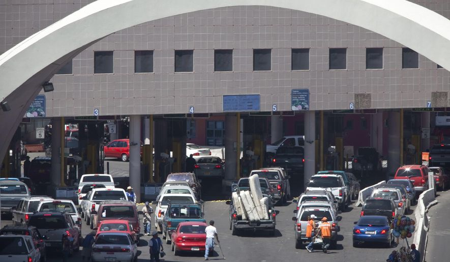 FILE - This June 1, 2009 file photo shows vehicles waiting to enter the U.S. through The Dennis DeConcini Port of Entry in downtown Nogales, Ariz. The mayor of Nogales says a port of entry on the U.S.-Mexico border is temporarily closed after a customs officer shot and killed a southbound driver who refused to stop Thursday night, Feb. 7, 2019. (Mark Henle/The Arizona Republic via AP, File)