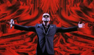 "FILE - In this Sept. 9, 2012 file photo, British singer George Michael performs at a concert to raise money for the AIDS charity Sidaction, during the Symphonica tour at Palais Garnier Opera house in Paris, France. Artworks collected by George Michael before his death in 2016 are going up for auction. Christie's is selling the music star's collection, including pieces by Damien Hirst, Tracey Emin and Sarah Lucas _ members of the ""Young British Artists"" generation who, like Michael, shook up Britain's creative scene in the 1980s and 90s. (AP Photo/Francois Mori, File)"