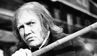 "In this Jan. 15, 1970, file photo, British actor Albert Finney waves his cane while playing the title role in ""Scrooge,"" at Shepperton Studios. British Actor Albert Finney, the Academy Award-nominated star of films from ""Tom Jones"" to ""Skyfall"" has died at the age of 82 his family said on Friday, Feb. 8, 2019. (AP Photo/R. Dear, File)"