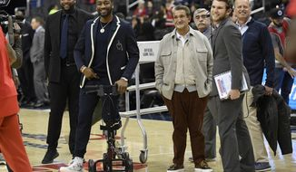 Washington Wizards guard John Wall, second from left, smiles next to team owner Ted Leonsis, third from left, before the team's NBA basketball game against the Cleveland Cavaliers, Friday, Feb. 8, 2019, in Washington. (AP Photo/Nick Wass) ** FILE **