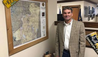 "RETRANSMISSION TO CORRECT PARTY AFFILIATION - Oregon state Sen. Dennis Linthicum, R-Klamath Falls, poses in his office in the Oregon State Capitol in Salem, Ore., Friday, Feb. 8, 2019. Linthicum is accused of racism by a fellow lawmaker for referencing the death of Eric Garner, a black man killed in New York by police using a chokehold, in a statement opposing cigarette taxes and using Garner's last words: ""I can't breathe."" (AP Photo/AndrewSelsky)"