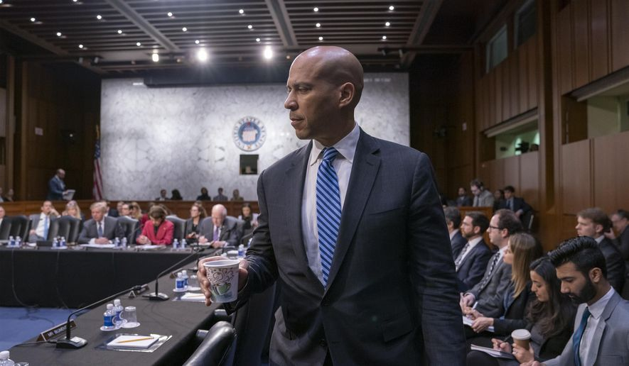 In this Feb. 7, 2019, photo, Senate Judiciary Committee member Sen. Cory Booker, D-N.J., arrives as the panel meets to vote on the nomination of William Barr to be attorney general, on Capitol Hill in Washington. Booker is taking his call for social justice to Iowa, where he plans to visit with black leaders this weekend on his first trip to the early 2020 caucus state as a Democratic presidential candidate. (AP Photo/J. Scott Applewhite)