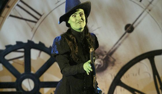 """FILE - In this June 6, 2004, file photo, actress Idina Menzel from the musical """"Wicked"""" performs during the 58th Annual Tony Awards at New York's Radio City Music Hall. Universal Pictures said Friday, Feb. 8, 2019, that the long-awaited movie version of the hit musical """"Wicked"""" will land in theaters on Dec. 22, 2021. It had originally been on the schedule for this December. The musical is a reimagining of """"The Wizard of Oz"""" told from the perspective of the witches. (AP Photo/Kathy Willens, File)"""