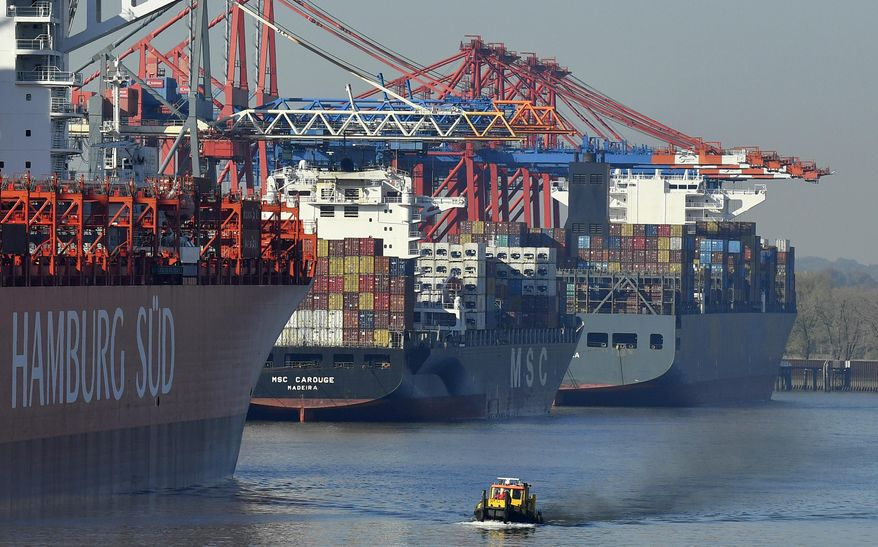 FILE - In this Oct. 15, 2018 file photo, container ships are loaded at the harbor in Hamburg, Germany. German imports and exports both rose unexpectedly strongly in December, increasing the trade surplus and providing a positive note about the strength of Europe's largest economy amid growing worries (AP Photo/Martin Meissner)