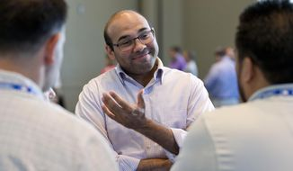 FILE - In this Nov. 11, 2015, file photo, then-Los Angeles Dodgers general manager Farhan Zaidi speaks to reporters at the baseball general managers' meetings in Boca Raton, Fla. The San Francisco Giants have had a quiet offseason, aside of course from acquiring new president of baseball operations Farhan Zaidi from the rival and six-time defending division champion Dodgers and challenging him with getting this proud franchise back into contention.  (AP Photo/Wilfredo Lee, File)
