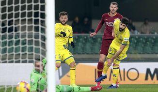 AS Roma's Edin Dzeko, second from right, scores against Chievo Verona during an Italian Serie A soccer match at Bentegodi stadium in Verona, Italy, Friday, Feb. 8, 2019. (Emanuele Pennacchio/ANSA via AP)