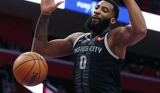 Detroit Pistons center Andre Drummond dunks during the first half of an NBA basketball game against the New York Knicks, Friday, Feb. 8, 2019, in Detroit. (AP Photo/Carlos Osorio)