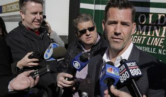 FILE - In this Feb. 4, 2019, file photo, New York Mets general manger Brodie Van Wagenen, right, speaks to reporters during a photo opportunity at Citi Field in New York. Heading into his first spring training as Mets GM, the former player agent has already overseen a major overhaul to the roster that has New York eyeing the playoffs in a beefed-up NL East. (AP Photo/Seth Wenig, File)