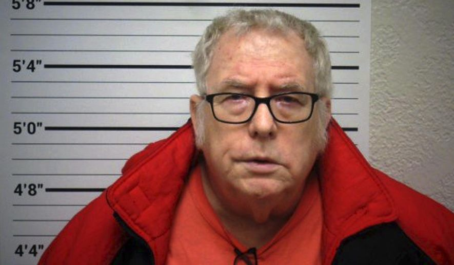 """FILE - This Dec. 13, 2018, file photo provided by the Custer County Sheriff's Office shows James """"Doc"""" Jensen Jr. in Miles City, Mont. Jensen, a former Montana high school athletic trainer accused of sexually abusing students, plans to plead guilty to a federal charge of coercion and enticement. (Custer County Sheriff's Office via AP, File)"""