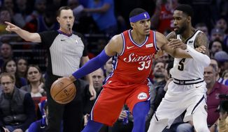 Philadelphia 76ers' Tobias Harris (33) drives to the basket against Denver Nuggets' Will Barton (5) during the first half of an NBA basketball game Friday, Feb. 8, 2019, in Philadelphia. (AP Photo/Matt Slocum)