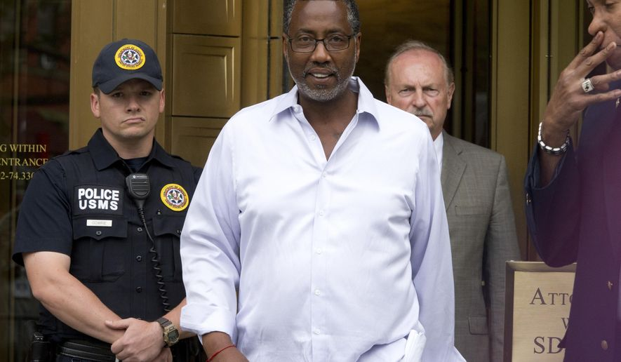 FILE- In this June 8, 2016, file photo, Norman Seabrook, center, president of the New York City Correction Officers' Benevolent Association, leaves court, in New York. Seabrook was sentenced to nearly 5 years in prison Friday, Feb. 8, 2019, after being found guilty last year on conspiracy and bribery. The longtime head of the nation's largest municipal jail guard union was paid tens of thousands of dollars in cash in exchange for steering $20 million in union money to a hedge fund. (AP Photo/Mary Altaffer, File)