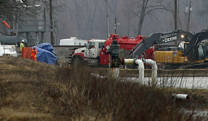 Excavation equipment is used to search for an oil leak close to where the TransCanada Corp's Keystone oil pipeline runs through northern St. Charles County off of Highway C, Thursday, Feb. 7, 2019, near St. Charles, Mo. The source of the oil leak has not yet been identified but the Keystone oil pipeline has been shut and the Missouri Department of Natural Resources official said the the release is stopped. (David Carson/St. Louis Post-Dispatch via AP)