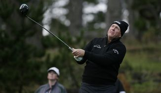 Phil Mickelson follows his drive from the 11th tee of the Spyglass Hill Golf Course during the second round of the AT&T Pebble Beach National Pro-Am golf tournament Friday, Feb. 8, 2019, in Pebble Beach, Calif. (AP Photo/Eric Risberg)
