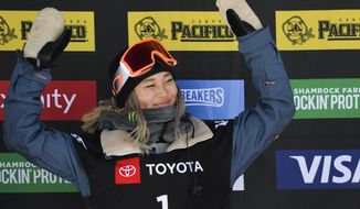 Gold medalist Chloe Kim, of the United States, celebrates after winning the women's snowboard halfpipe final at the freestyle ski and snowboard world championships, Friday, Feb. 8, 2019, in Park City, Utah. (AP Photo/Alex Goodlett)