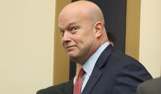 Acting Attorney General Matthew Whitaker walks in to appear before the House Judiciary Committee on Capitol Hill, Friday, Feb. 8, 2019 in Washington. Democrats are eager to press him on his interactions with President Donald Trump and his oversight of the special counsel's Russia investigation. (AP Photo/Andrew Harnik)