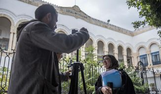 Imen Triqui, one of the defense lawyers talks to the Associated Press outside the Hall of Justice in Tunis, Friday, Feb.8, 2019. More than 40 people have been summoned to face trial over Tunisia's deadliest attack in a Mediterranean resort in 2015 and the verdict in expected Friday Feb.8, 2019, more than 3-1/2 years after the attack on the Imperial Hotel in the beach resort of Sousse left 38 people dead, mostly British tourists (AP Photo/Hassene Dridi)