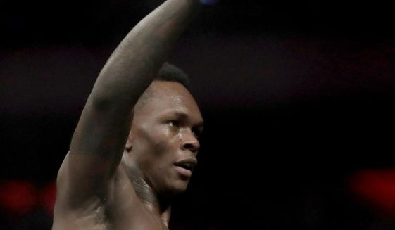 FILE - In this Nov. 3, 2018, file photo, Israel Adesanya reacts after defeating Derek Brunson during the first round of a middleweight mixed martial arts bout at UFC 230 at Madison Square Garden in New York. Adesanya faces Brazilian mixed martial arts trailblazer Anderson Silva on Sunday in Melbourne, Australia. (AP Photo/Julio Cortez, File)