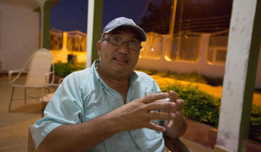 In this Dec. 10, 2018 photo, Nieves Ribullen speaks during a interview at his home in Punto Fijo, Venezuela. Ribullen, a Venezuelan oil worker sick of struggling to get by as his country falls apart, is betting it all on far-away job in Kurdistan to give his family a better life.(AP Photo/Fernando Llano)