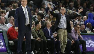 Milwaukee Bucks head coach Mike Budenholzer, left, reacts during the first half of an NBA basketball game against the Washington Wizards Wednesday, Feb. 6, 2019, in Milwaukee. (AP Photo/Aaron Gash)