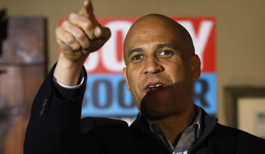 "U.S. Sen. Cory Booker, D-N.J., speaks during a ""meet and greet"" with local residents, Saturday, Feb. 9, 2019, in Marshalltown, Iowa. (AP Photo/Charlie Neibergall)"