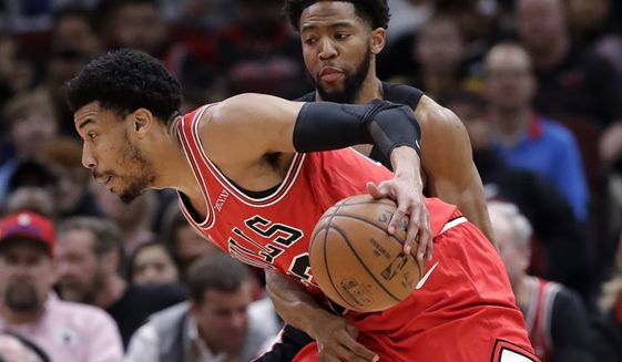 Chicago Bulls forward Otto Porter Jr., left, drives against Washington Wizards guard Chasson Randle during the first half of an NBA basketball game Saturday, Feb. 9, 2019, in Chicago. (AP Photo/Nam Y. Huh)