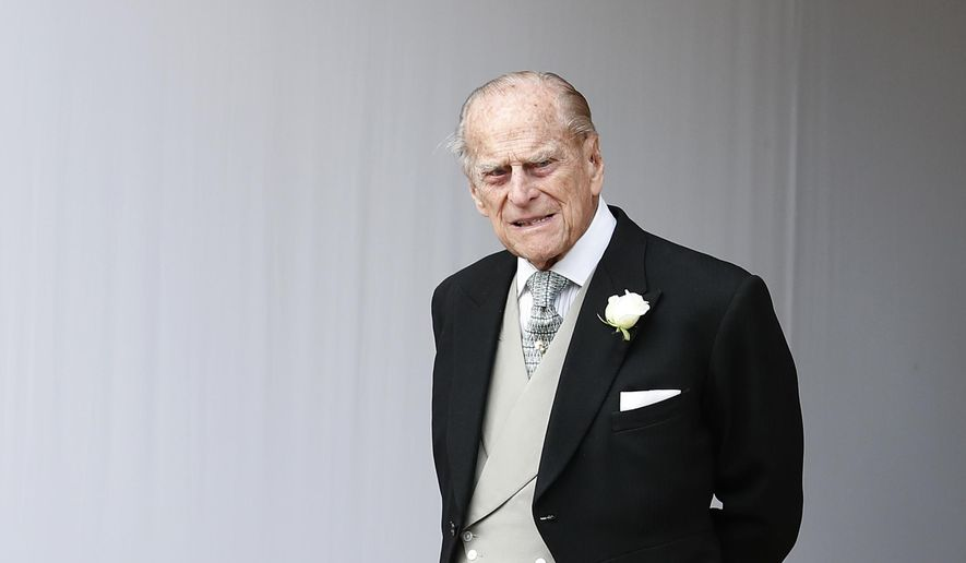 In this Friday, Oct. 12, 2018 file photo, Britain's Prince Philip waits for the bridal procession following the wedding of Princess Eugenie of York and Jack Brooksbank in St George's Chapel, Windsor Castle, near London, England. Buckingham Palace said Saturday, Feb. 9, 2019, that 97-year-old Prince Philip has decided to stop driving, less than a month after he was involved in a collision that left two women injured. (AP Photo/Alastair Grant, Pool, File)