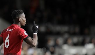 Manchester United's Paul Pogba celebrates after scoring his side's third goal from penalty during the English Premier League soccer match between Fulham and Manchester United at Craven Cottage stadium in London, Saturday, Feb. 9, 2019. (AP Photo/Matt Dunham)