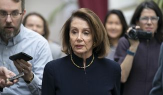 Speaker of the House Nancy Pelosi, D-Calif., walks with reporters to a Democratic Caucus meeting the morning after President Donald Trump's State of the Union speech, on Capitol Hill in Washington, Wednesday, Feb. 6, 2019. (AP Photo/J. Scott Applewhite)