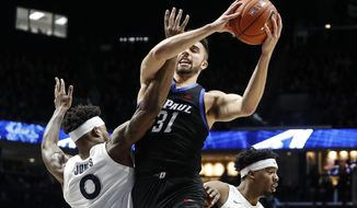 DePaul's Max Strus (31) shoots against Xavier's Tyrique Jones (0) during the second half of an NCAA college basketball game, Saturday, Feb. 9, 2019, in Cincinnati. (AP Photo/John Minchillo) ** FILE **