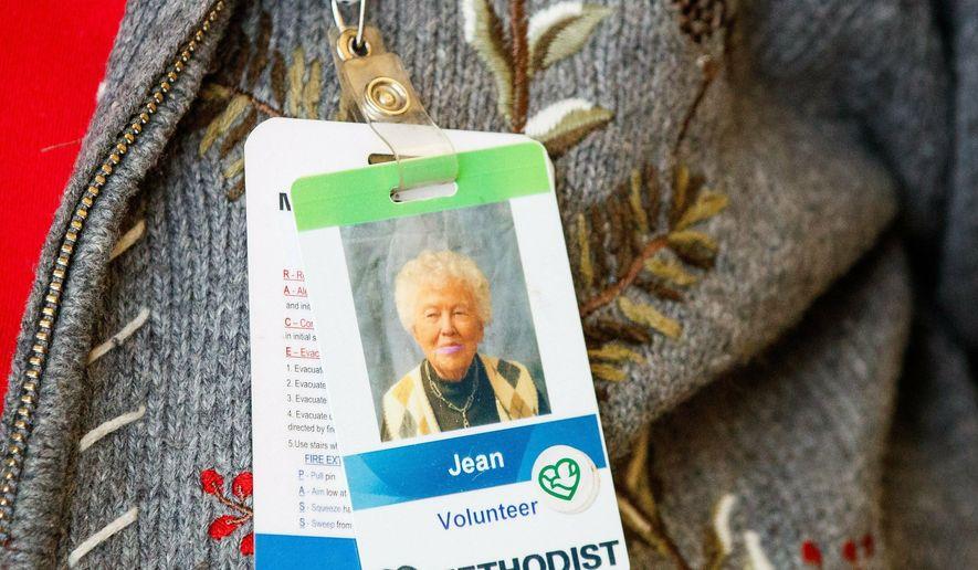 In this Monday, Jan. 28, 2019 photo, Jean Bailey, 98, works as a volunteer at Methodist Women's Hospital  in Omaha, Neb. (Ryan Soderlin /Omaha World-Herald via AP)