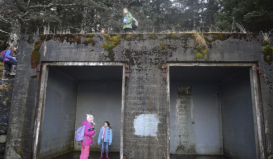 In this Jan. 25, 2019, photo, Peterson Elementary students explore an old WWII-era Army building at Fort Abercrombie State Park's Miller Point in Kodiak, Alaska. A group of the school's third-graders glimpsed snapshots of World War II history on Kodiak Island when they visited the Kodiak Military Museum at Fort Abercrombie State Historical Park on a crisp, clear Jan. 25 morning. (Jack Barnwell/Kodiak Daily Mirror via AP)