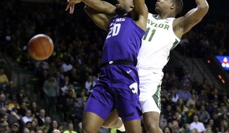 Baylor guard Mark Vital, right, breaks up ta shot by Kansas State forward Xavier Sneed, left, in the first half of an NCAA college basketball game, Saturday, Feb. 9, 2019, in Waco, Texas. (Rod Aydelotte/Waco Tribune Herald, via AP)