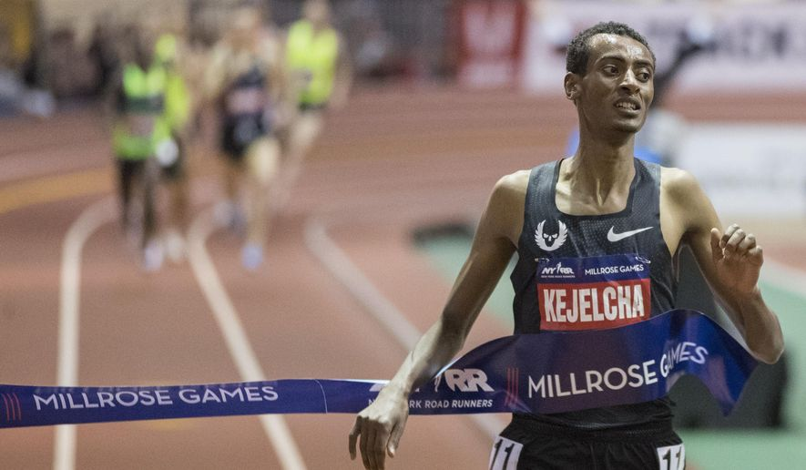 Yomif Kejelcha, of Ethiopia crosses the finish line in the men's Wanamaker Mile at the Millrose Games track and field meet, Saturday, Feb. 9, 2019, in New York. (AP Photo/Mary Altaffer)