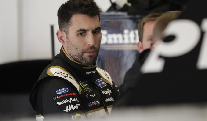 Aric Almirola looks over his car in his garage after NASCAR auto race practice at Daytona International Speedway, Saturday, Feb. 9, 2019, in Daytona Beach, Fla. (AP Photo/John Raoux)