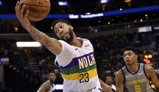 New Orleans Pelicans forward Anthony Davis (23) reaches for the ball ahead of Memphis Grizzlies forward Bruno Caboclo (5) during the first half of an NBA basketball game Saturday, Feb. 9, 2019, in Memphis, Tenn. (AP Photo/Brandon Dill)