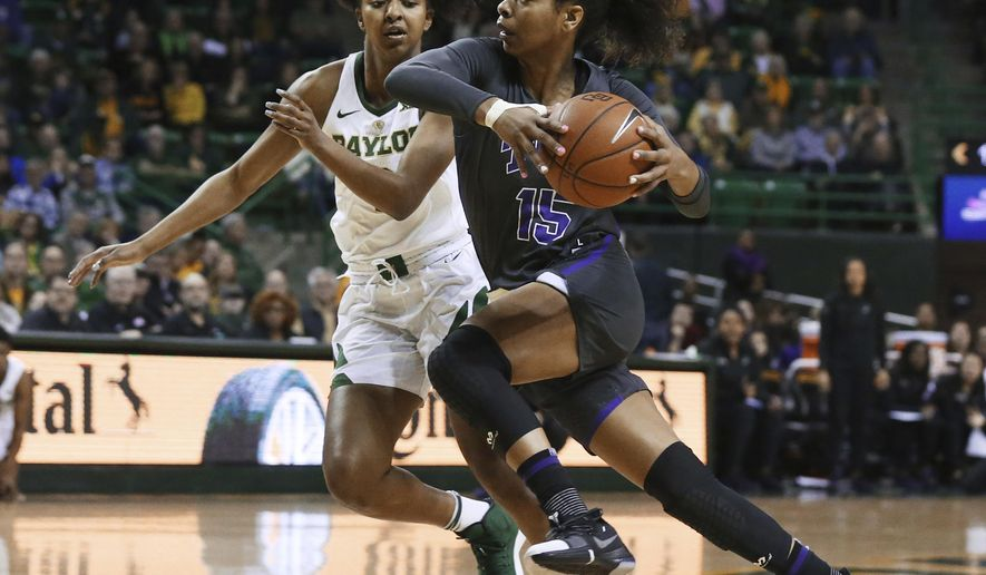 TCU guard Jayde Woods, right, drives toward the basket past Baylor guard DiDi Richards, left, in the first half of an NCAA college basketball game, Saturday, Feb. 9, 2019, in Waco, Texas. (AP Photo/Rod Aydelotte)