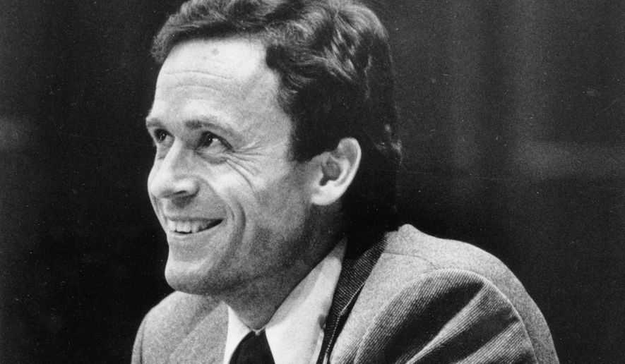 FILE - In this June 27, 1979 file photo, Ted Bundy smiles during the second day of jury selection for his murder trial in a Dade County courtroom in Miami, Fla. Bundy is being tried for the murders of two women in Tallahassee on Jan. 15, 1978. (AP Photo)