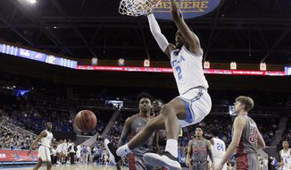 UCLA forward Cody Riley (2) dunks against Utah during the first half of an NCAA college basketball game Saturday, Feb. 9, 2019, in Los Angeles. (AP Photo/Marcio Jose Sanchez)
