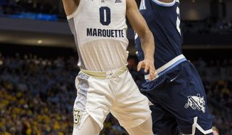 Marquette guard Markus Howard, left, goes up for a basket against Villanova during the first half of an NCAA college basketball game Saturday, Feb. 9, 2019, in Milwaukee. (AP Photo/Darren Hauck)