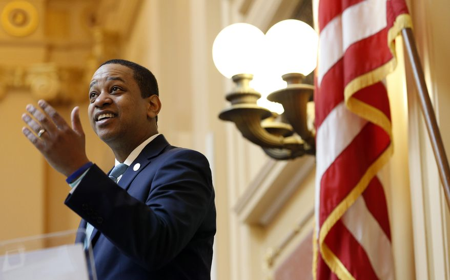 Virginia Lt. Gov Justin Fairfax welcomes visitors to the gallery at the opening of the senate session at the Capitol in Richmond, Va., Thursday, Feb. 7, 2019. A California woman has accused Fairfax of sexually assaulting her 15 years ago. (AP Photo/Steve Helber)