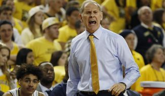 Michigan head coach John Beilein shouts during the first half of an NCAA college basketball game against Wisconsin, Saturday, Feb. 9, 2019, in Ann Arbor, Mich. (AP Photo/Carlos Osorio)