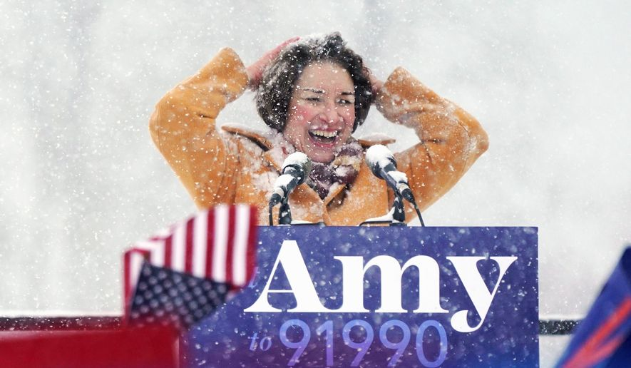 """""""I don't have a political machine,"""" said Sen. Amy Klobuchar, Minnesota Democrat. """"I don't come from money, but what I do have is this — I have grit."""" (Associated Press)"""