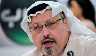 In this Dec. 15, 2014, file photo, Saudi journalist Jamal Khashoggi speaks during a press conference in Manama, Bahrain. (AP Photo/Hasan Jamali, File)