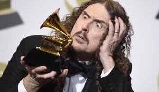 """Weird Al"" Yankovic poses in the press room with the award for best boxed or special limited edition package for ""Squeeze Box: The Complete Works of 'Weird Al' Yankovic"" at the 61st annual Grammy Awards at the Staples Center on Sunday, Feb. 10, 2019, in Los Angeles. (Photo by Chris Pizzello/Invision/AP)"