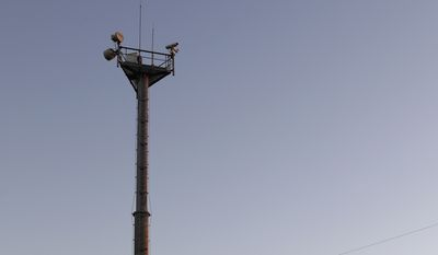"In this Tuesday, Nov. 15, 2016, photo, a U.S. Customs and Border Patrol passes a Remote Surveillance Camera Systems tower stationed along a section of border in Brownsville, Texas. Since tower-mounted Border Patrol video surveillance cameras began going up in 1999 in the Brownsville area, illegal cross-border ""traffic dried up by 85-90 percent,"" said Johnny Meadors, the sector's assistant chief for technology. (AP Photo/Eric Gay)"