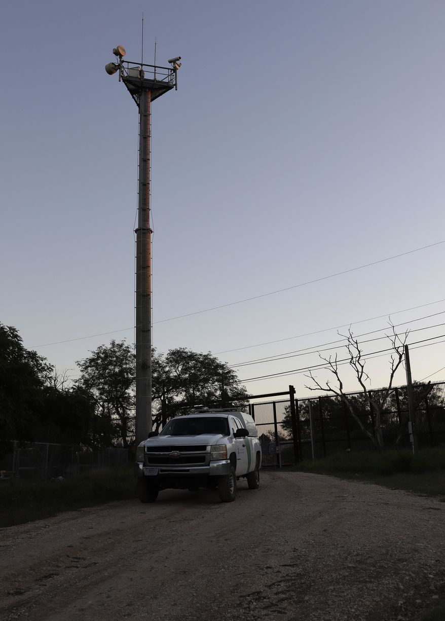 """In this Tuesday, Nov. 15, 2016, photo, a U.S. Customs and Border Patrol passes a Remote Surveillance Camera Systems tower stationed along a section of border in Brownsville, Texas. Since tower-mounted Border Patrol video surveillance cameras began going up in 1999 in the Brownsville area, illegal cross-border """"traffic dried up by 85-90 percent,"""" said Johnny Meadors, the sector's assistant chief for technology. (AP Photo/Eric Gay)"""